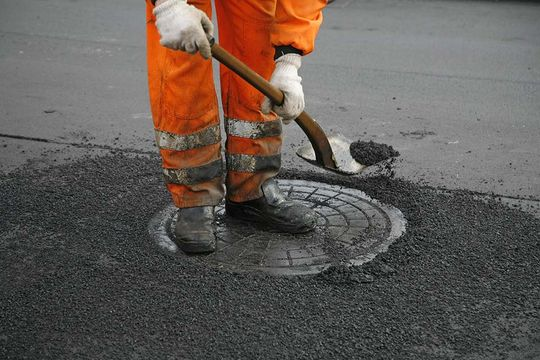 Man at Work on Manhole